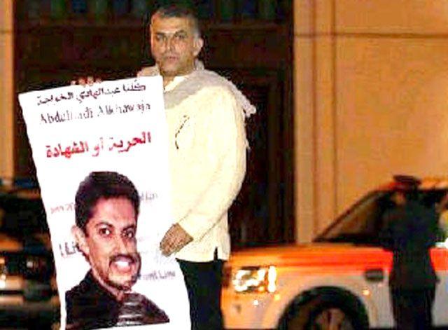 رجب في إحدى المسيرات المطالبة بالإفراج عن الخواجة
