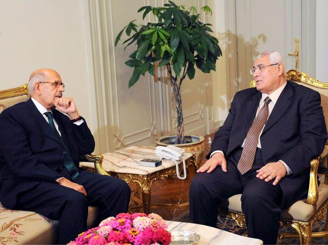 الرئيس المصري المؤقت مجتمعاً مع محمد البرادعي - REUTERS