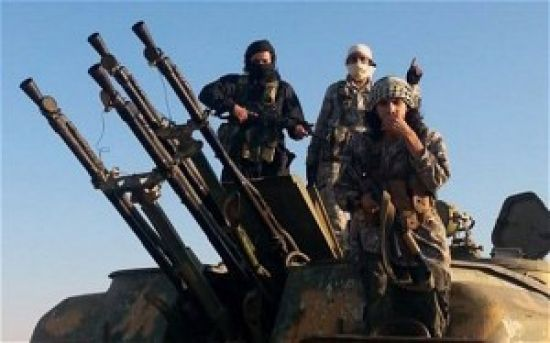IS fighters on top of a military vehicle with<br />anti-aircraft guns in Raqqa - Picture: Raqqa Media<br />Center/AP