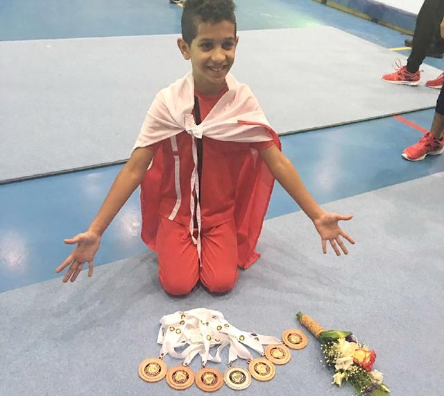 عبدالله النايف يستعرض ميدالياته السبع