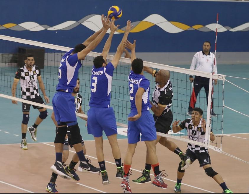 علي مرهون يحاول إسقاط الكرة خلف حوائط صد النصر