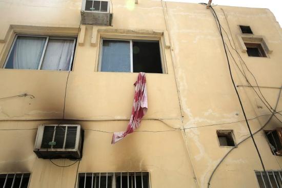 المبنى الذي تعرض للحريق في المحرق